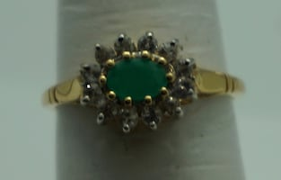 14kt yellow gold ring with emeralds and 0.25 carat of diamonds . 2.5 gr total weight . Size 7. Pre owned. very good condition . 741767-2.