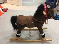"Black and brown rocking horse ""from Santa"" ribbon Newmarket, L3Y 6B7"