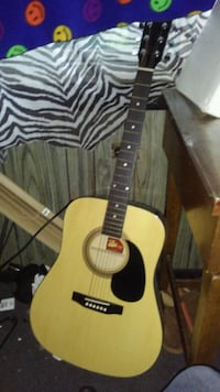 brown and black acoustic guitar Byron, 48418