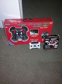 black and red quadcopter dronme(built in camera)