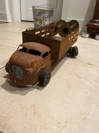 Very old metal toy truck.
