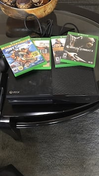 Black Xbox one 500 GB with one black controller and cooler Louisville