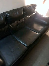 Black leather couch 1 yr old Brantford, N3P 1E3