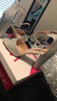 Pair of silver, diamond covered high heel shoes