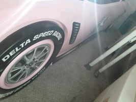 2 brand new racecar  bed frames and brand new box springs  and 2 brand