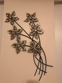 "Wall art 24"" high gold in color"