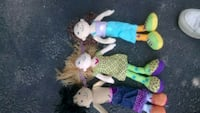three assorted color dressed dolls