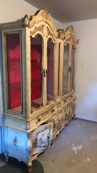 Brown wooden framed glass display cabinet New York, 10308