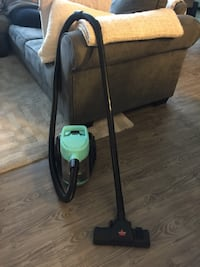 black and green canister vacuum cleaner Calgary, T2R 0J4