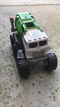 White and green plastic garbage compactor toy