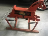 Buster brown rocking horse in working condition and a true antique
