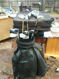 black golf bag with golf clubs Tomball, 77377