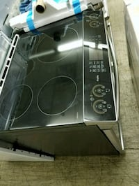 GE. GLASS TOP ELECTRIC STOVE SLIDE IN  Barrie, L4N 4T8