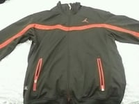 black and orange zip-up jacket