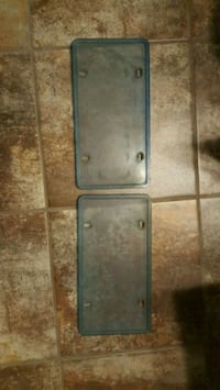 Blue licence plate covers