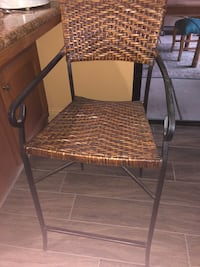 Brown and black wicker chair