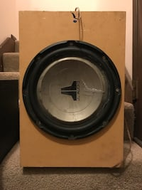 round black and gray JL Audio subwoofer