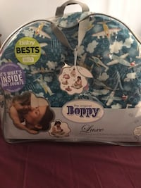White and blue boppy nursing pillow