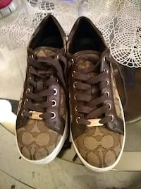 pair of brown Coach low-top sneakers Albuquerque, 87108