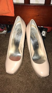 pair of beige leather heeled shoes