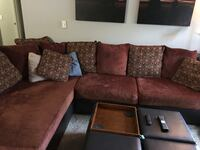 Red sectional w/ throw pillows w/ matching ottoman