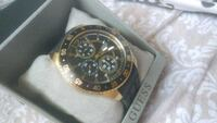 round gold-colored chronograph watch with black le Cambridge, N3H 1B6