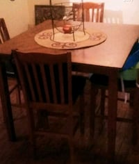 rectangular brown wooden table with four chairs dining set Laval, H7P 4N2