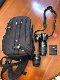 Black dslr camera with bag