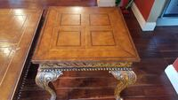square brown wooden table with cabriole leg