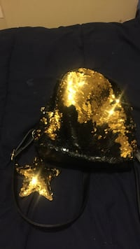 gold-colored and black sequinned handbag