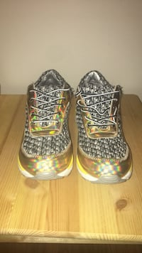 pair of gold-and-gray mid-top sneakers