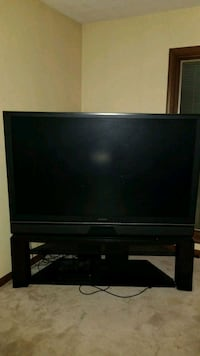 black flat screen TV with black wooden TV stand Fort Wayne, 46835