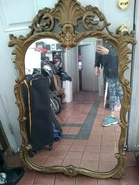 rectangular leaning mirror with brown ornate frame North Las Vegas, 89030