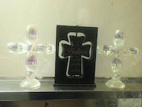 two clear glass candle holders 28 mi