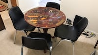 round brown wooden table with four chairs Gaithersburg, 20878