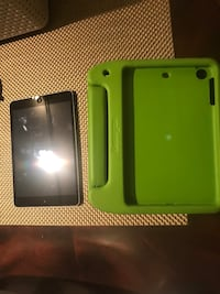 black iPad with green case 25 mi