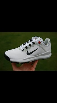 unpaired white and black Nike athletic shoe