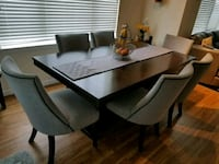 rectangular brown wooden table with 8 chairs din Littleton, 80121