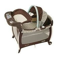 baby's brown and white travel cot Bakersfield, 93307
