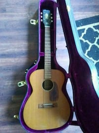 brown acoustic guitar with case Boise, 83705
