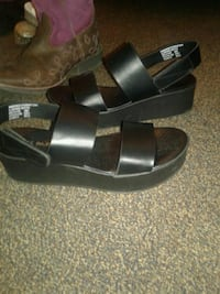pair of black leather slide sandals Anderson, 96007