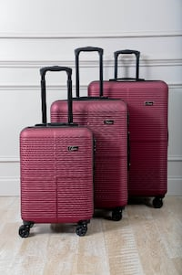 three red hard-shell luggages PISCATAWAY