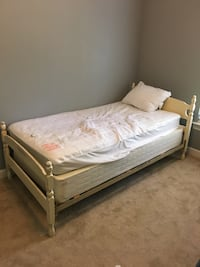 Antique twin bed with match mirror, newer mattress included