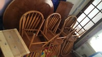 Wooden table with 6 chairs and a leaf  578 mi