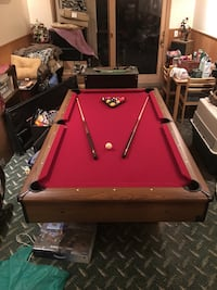 Red and brown wooden slate top pool table