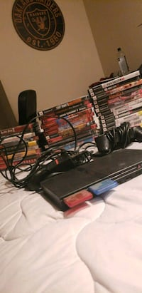 black Sony PS2 slim console with controller and ga Vancouver, 98684