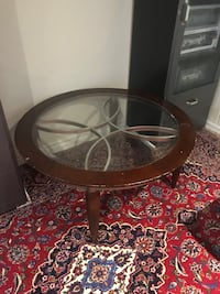 round brown wooden framed glass top coffee table Toronto, M5R 1R2