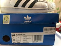 unpaired black and white Adidas Superstar Toronto, M6L 1B4