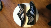 Pair of new never worn mens coach shoes size 9 Kamloops, V2B 4P3