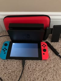 Brand New Nintendo Switch. It has a charging station and a carrying case. Mc Donald, 15057